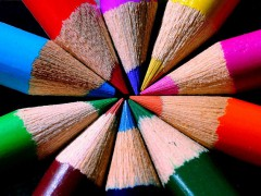 colored pencils arranged with their tips in the center