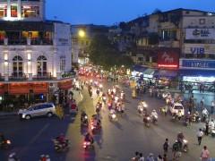 Evening traffic on Le Thai To Street in Hanoi, Vietnam.