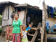 Subsistence farmer, Kaum, with her children in Phonethong Village