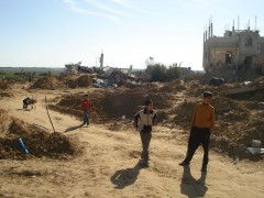 Boys are playing in between the ruins of Gaza City.