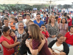 Salvadoran First Lady, Vanda Pignato, receives a hug from a supporter at an International Women's Day event in San Salvador. Photo by Jamie Stark.